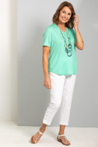 Female women model wearing fella hamilton hedrena clothes with a green shirt and white pants